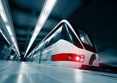 Motion blurred rapid train on station