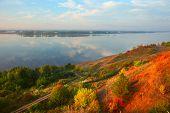 pic of kama  - Big river Kama in sunrise light with autumn trees on a coast - JPG
