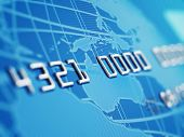 A close up of a bogus credit card Depth of field showing the numbers. Globe and credit card designed