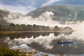 stock photo of bute  - Low cloud drifts down the mountain to Loch Etive in Argyll and Bute Scotland - JPG