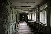 Постер, плакат: school room with turned chairs and opened window frames in Pripyat Chernobyl Ukraine