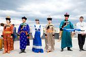 Actors In Russian And Buryat National Costumes