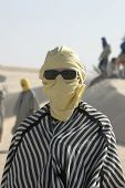 Tourist Dressed Like Bedouin With Sunglasses poster