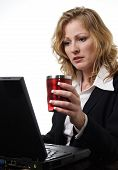 Business Woman Working And Holding Cup Of Coffee