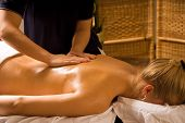 picture of massage therapy  - woman at a day spa getting a nice massage - JPG