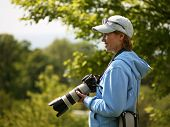 The Woman With The Camera In The Nature