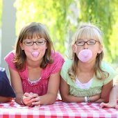 Two girls blowing bubbles