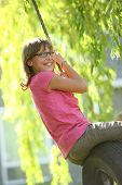 image of tire swing  - Girl swinging on tire swing - JPG