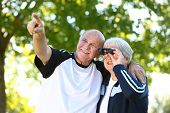 Senior couple looking through binoculars
