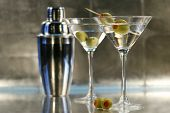 Martinis with olives and shaker on bar
