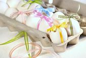 stock photo of happy easter  - Eggs with ribbons ready for Easter festivities - JPG