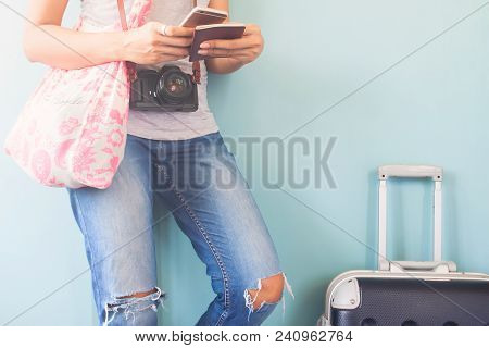 poster of Woman Traveler Using Smart Phone And Passport Book With Traveler Suitcase, Happy And Travel Lifestyl