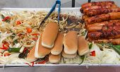 Hot Dog Street Vendor Grill With Bacon Wrapped Hot Dogs, Onions, Peppers, Jalapenos On A Steaming Gr poster