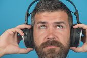 Dreamy Calm Bearded Man Listening Music In Headphones. Young Man Enjoying Music In His Headphones, L poster