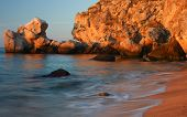 stock photo of azov  - Sea of Azov beach with rocks at the sunset background - JPG