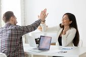 Young Asian And Caucasian Partners Giving High Five At Workplace, Diverse Motivated Colleagues Celeb poster