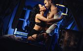 Couple Indoors. Sensual Brunette In Black Lingerie And Handsome Man Kissing. Office Romance Concept poster