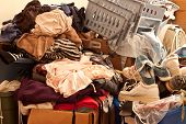 image of shoe-box  - Pile of misc items stored in an unorganized fashion in a room - JPG