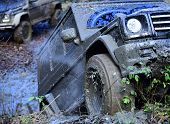 Dirty Wheels Of Car Spinning In Mud. Suv In Autumn Forest, Defocused. Offroad Race On Fall Day. Extr poster