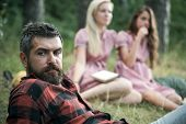 Bearded Man With Blue Eyes Spending Time With Friends Outdoors. Closeup Handsome Man In Lumberjack S poster