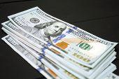 Dollars money cash on black background. Heap of money poster