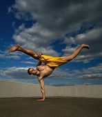 Tricking On Street. Martial Arts. Man Kick With Hand Support Barefoot. Shooted From Bottom Foreshort poster