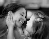 Beautiful mother and daughter share a tender moment black and white poster