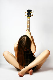 stock photo of denude  - denuded girl with guitar - JPG