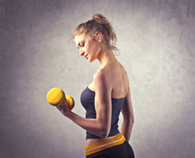 stock photo of weight-lifting  - Young woman lifting weights - JPG