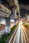 Traffic on Rama I street at Pathumwan junction in Bangkok, Thailand. Pathumwan junction is one of th poster