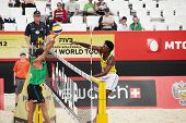 MOSCOW, RUSSIA - JUNE 8: Thiago Santos Barbosa (right) and Ferramenta, Brazil vs C. McHugh - Joshua Slack (left), Australia, during Beach Volleyball Swatch World Tour in Moscow, Russia at June 8, 2012