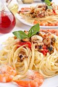 two servings of pasta linguine with delicious marinara sauce and seafood