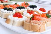 large group of sandwiches with seafood