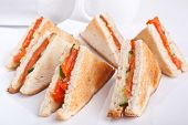 six salmon club  sandwiches