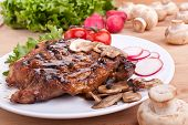 stock photo of pork chop  - one serving of pork chop with mushrooms and radish - JPG