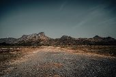 Country Road In The Mountains . A Wide Empty Road In The Desert Toward Distant Mountains . Gravel An poster