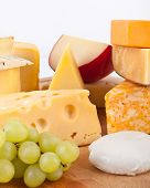 Various types of cheese with grapes