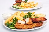 picture of halibut  - two servings of fish and chips on white background - JPG