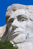 stock photo of mount rushmore national memorial  - Abraham Lincoln face on Mount Rushmore National Memorial - JPG