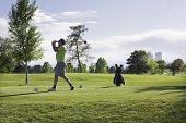 Man golfing at City Park, Denver
