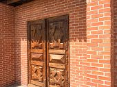 Old Wooden Entrance Door. Antique Brown Wooden Door. Wooden Door With Red Bricks. Asian House. poster