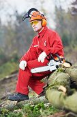 Forest woodcutter lumberjack Worker in protective safety work wear With Chainsaw