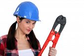 Female builder with boltcutters