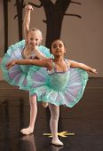 picture of tight dress  - Two ballet students in fancy dresses posing together - JPG