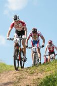 MOSCOW, RUSSIA - JUNE 9: A. Gehbauer (Austria, left), T.Ivanov (Russia, center) and R.Indergand (Switzerland) in the European Mountain Bike Cross-Country Championship in Moscow, Russia at June 9, 2012