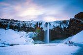 Iceland seljalandsfoss waterfall, winter in Iceland, seljalandsfoss waterfall in winter poster