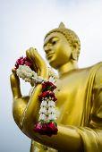 Garland In Hand Of Buddha