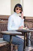 Leisure Concept. Woman Attractive Elegant Brunette Spend Leisure Cafe Terrace Background. Pleasant T poster