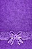 Elegant Shiny Purple Glitter Bow On Purple Colored Ribbon And On Purple Burlap. Vertical Greeting Ca poster