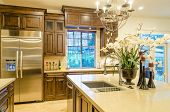 stock photo of mansion  - Modern kitchen in luxury house - JPG